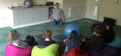 CCHP Riverside Unit - Group of young people in a therapy session